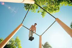 Adult Man Training Chest Muscles Doing Calisthenics Workout Outdoors stock image
