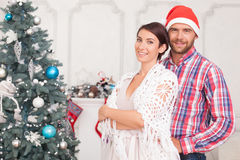 Beautiful young married couple near New Year tree Royalty Free Stock Photography