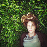 Beautiful young meditative woman in the grass. Instagram effect. Royalty Free Stock Photos
