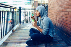 Beautiful young middle eastern appearance man with beard in hoodie blowing bubbles Stock Photo