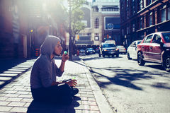 Beautiful young middle eastern appearance man with beard in hoodie blowing bubbles Royalty Free Stock Photo
