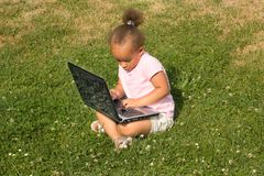 Beautiful young mixed race girl using laptop Royalty Free Stock Images