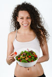 Beautiful young mixed woman with salad, isolated on white Royalty Free Stock Photo