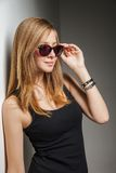 Beautiful young model with big glasses-close up Stock Image