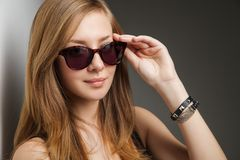 Beautiful young model with big glasses-close up Stock Photography