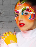 Beautiful young model with bright creative make up with helmet Royalty Free Stock Photo