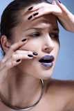 Beautiful young model with bright make-up and manicure Royalty Free Stock Image