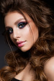 Beautiful young model with bright makeup and sunburn skin Evening make up Stock Photo