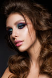 Beautiful young model with bright makeup and sunburn skin Evening make up Royalty Free Stock Image