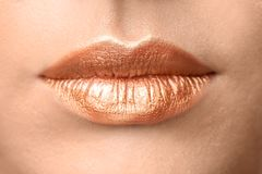 Beautiful young model with creative lips makeup,. Closeup royalty free stock images