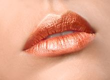 Beautiful young model with creative lips makeup. Closeup royalty free stock images