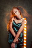 Beautiful young model dancing in mixed light at dark studio Stock Images