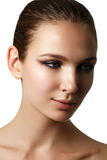 Beautiful young model with dark fashion make-up. Purity skin. Be Stock Photo