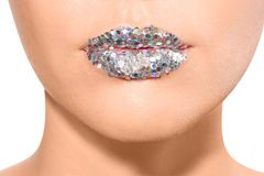 Beautiful young model with extravagant lips makeup on white background royalty free stock photos