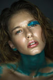 Beautiful young model with fashion wet colorful makeup. Royalty Free Stock Images