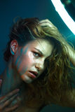Beautiful young model with fashion wet colorful makeup. Stock Image