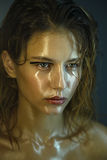 Beautiful young model with fashion wet makeup. Stock Photo