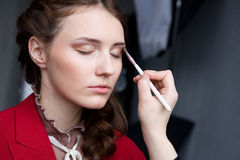 Beautiful young model getting fashion make-up Royalty Free Stock Image