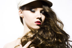 Beautiful young model in hat Royalty Free Stock Image