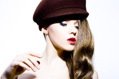 Beautiful young model in hat Stock Images