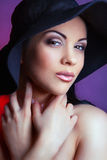 Beautiful young model in hat. Stock Image