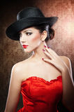 Beautiful young model in hat on the background in studio Royalty Free Stock Photo