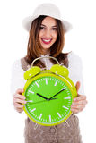 Beautiful young model with hat and showing clock Stock Images