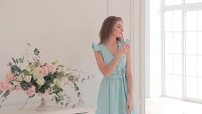 Beautiful young model in light blue dress posing for a catalog photo stock video footage