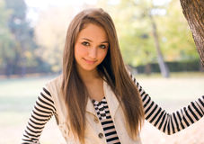 Beautiful young model in the park. Royalty Free Stock Photo