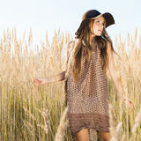 Beautiful young model passing tallgrass meadow - outdoors shot Royalty Free Stock Photos