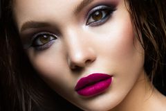 Beautiful young model with pink lips Stock Images