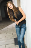 Beautiful young model posing in jeans. Royalty Free Stock Photos