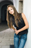Beautiful young model posing in jeans. Stock Images