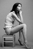 Beautiful young model posing in the studio with different emotions. Black and white photo stock photo