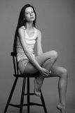 Beautiful young model posing in the studio with different emotions. Black and white photo royalty free stock image