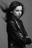 Beautiful young model posing in the studio with different emotions. Black and white photo stock image