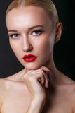 Beautiful young model with red lips and blond hair. Gorgeous Woman Face.  Perfect makeup. Beauty fashion Stock Photography