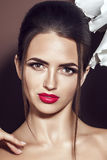Beautiful young model with red lips and manicure stock photo