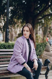 Beautiful young model. Sitting on a bench and posingr Stock Photo
