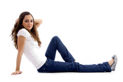 Beautiful young model sitting on ground Royalty Free Stock Photo