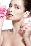 Beautiful young model spraying a flowers fragrance on her body Stock Images