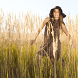 Beautiful young model in tallgrass meadow - outdoors shot Royalty Free Stock Photo