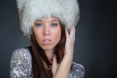 beautiful young model in winter fur hat Royalty Free Stock Photos