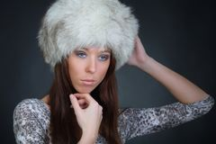 Beautiful young model in winter fur hat Stock Photography