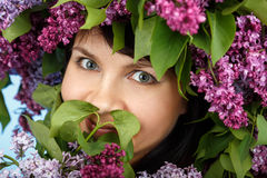 Beautiful young model woman with lilac bouquet and wreath Royalty Free Stock Photo
