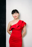 Beautiful young model woman in red dress posing over white backg Royalty Free Stock Photography