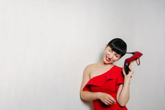 Beautiful young model woman in red dress posing over white backg Royalty Free Stock Images