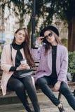 Beautiful young models. Beautiful young model posing on the streetr Royalty Free Stock Photos