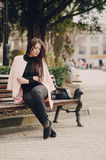 Beautiful young models. Beautiful young model sitting on a bench and posingr Stock Photography