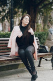 Beautiful young models. Beautiful young model sitting on a bench and posingr Royalty Free Stock Photo